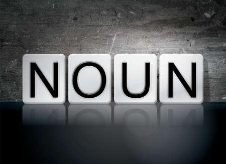 verb: The word Noun written in white tiles against a dark vintage grunge background. Stock Photo