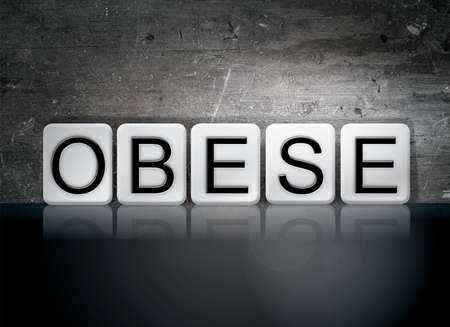 childhood obesity: The word Obese written in white tiles against a dark vintage grunge background. Stock Photo