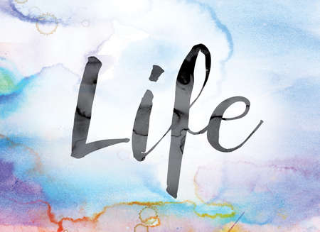 The word Life painted in black ink over a colorful watercolor washed background concept and theme. Фото со стока