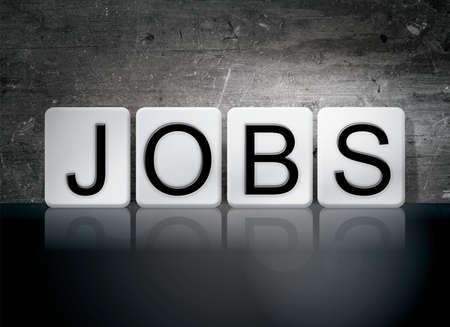 servitude: The word Jobs written in white tiles against a dark vintage grunge background.