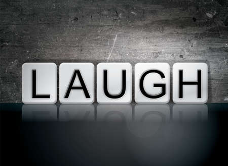 gag: The word Laugh written in white tiles against a dark vintage grunge background. Stock Photo