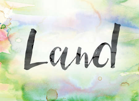 The word Land painted in black ink over a colorful watercolor washed background concept and theme.