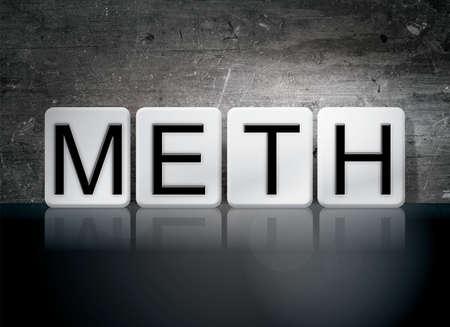 meth: The word Meth written in white tiles against a dark vintage grunge background. Stock Photo