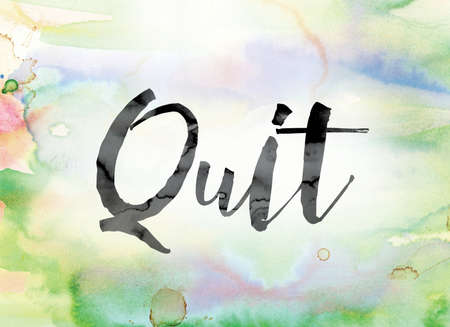 The word Quit painted in black ink over a colorful watercolor washed background concept and theme.