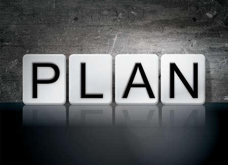 schemes: The word Plan written in white tiles against a dark vintage grunge background. Stock Photo