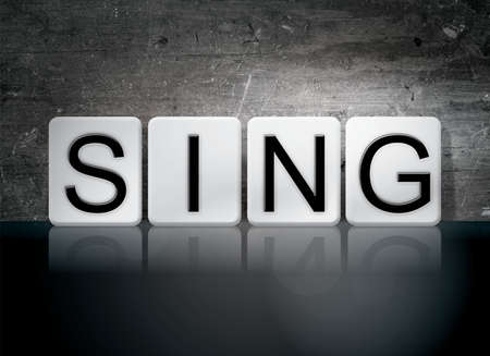 chorale: The word Sing written in white tiles against a dark vintage grunge background. Stock Photo