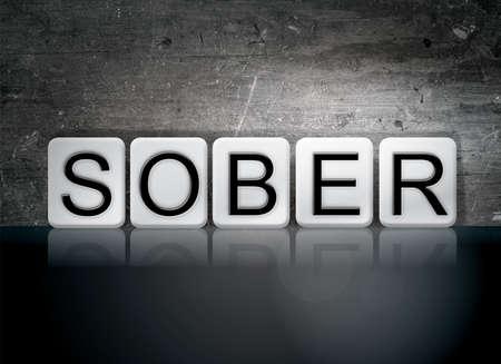 The word Sober written in white tiles against a dark vintage grunge background.