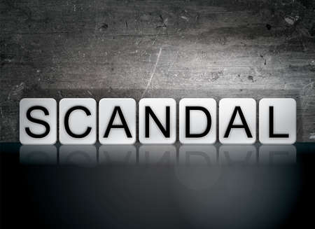 scandalous: The word Scandal written in white tiles against a dark vintage grunge background. Stock Photo