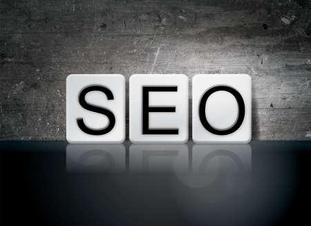 The word SEO written in white tiles against a dark vintage grunge background.