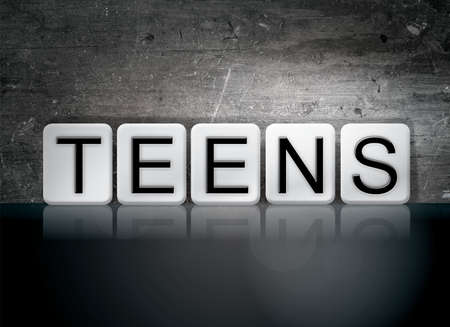 youthfulness: The word Teens written in white tiles against a dark vintage grunge background.