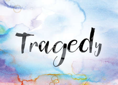The word Tragedy painted in black ink over a colorful watercolor washed background concept and theme. Stock Photo