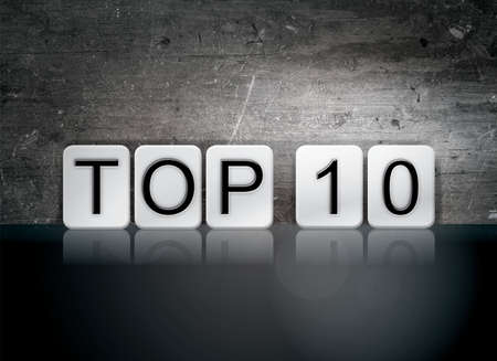 top 10: The word Top 10 written in white tiles against a dark vintage grunge background. Stock Photo