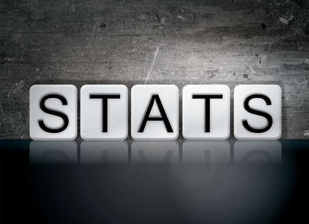 The word Stats written in white tiles against a dark vintage grunge background.