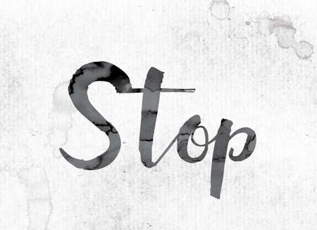 The word Stop concept and theme painted in watercolor ink on a white paper.