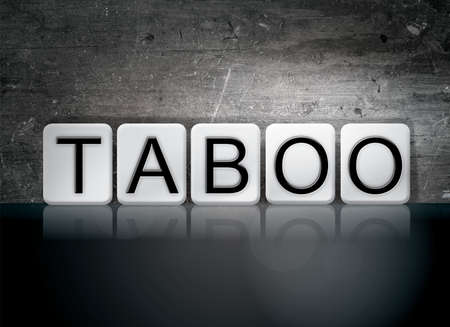 The word Taboo written in white tiles against a dark vintage grunge background.
