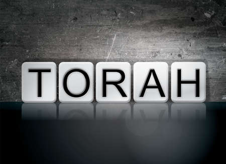 tabernacle: The word Torah written in white tiles against a dark vintage grunge background.