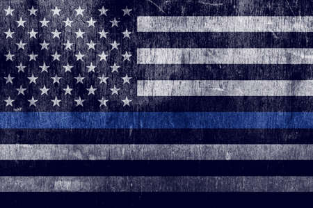 An aged textured law enforcement support flag with a thin blue line. Stock Photo