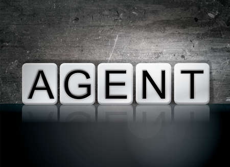 The word Agent concept and theme written in white tiles on a dark background. Фото со стока