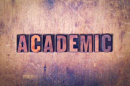 The word Academic concept and theme written in vintage wooden letterpress type on a grunge background.