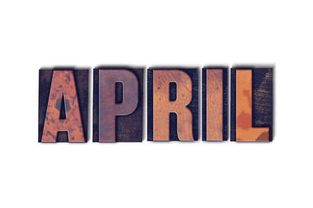 letterpress words: The word April concept and theme written in vintage wooden letterpress type on a white background. Stock Photo