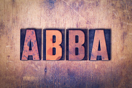 The word ABBA concept and theme written in vintage wooden letterpress type on a grunge background.