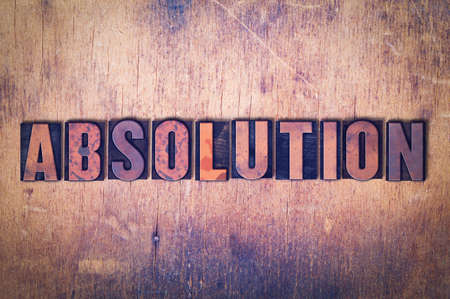 The word Absolution concept and theme written in vintage wooden letterpress type on a grunge background.