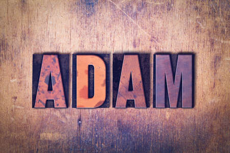 The name ADAM concept and theme written in vintage wooden letterpress type on a grunge background. Imagens