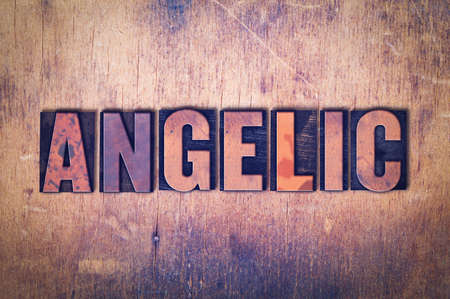 The word Angelic concept and theme written in vintage wooden letterpress type on a grunge background.