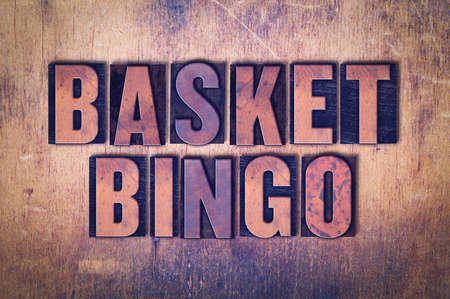 The words Basket Bingo concept and theme written in vintage wooden letterpress type on a grunge background.