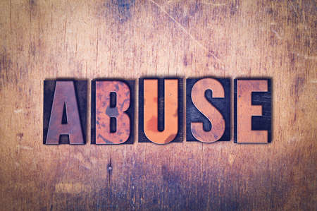 The word Abuse concept and theme written in vintage wooden letterpress type on a grunge background.