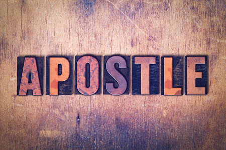 The word Apostle concept and theme written in vintage wooden letterpress type on a grunge background.