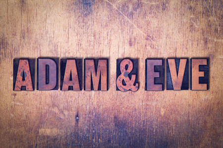 Adam and Eve concept and theme written in vintage wooden letterpress type on a grunge background.