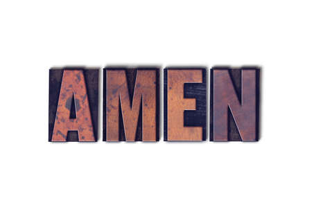 The word Amen concept and theme written in vintage wooden letterpress type on a white background.