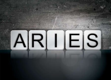 The word Aries concept and theme written in white tiles on a dark background. Imagens