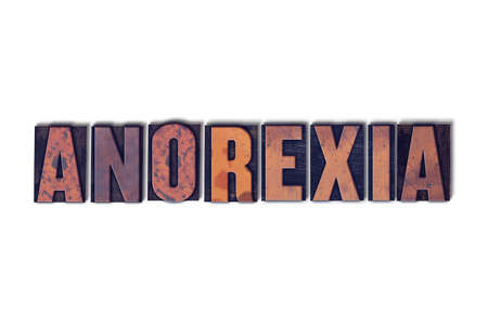 letterpress words: The word Anorexia concept and theme written in vintage wooden letterpress type on a white background. Stock Photo