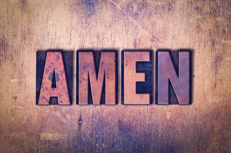 The word Amen concept and theme written in vintage wooden letterpress type on a grunge background.
