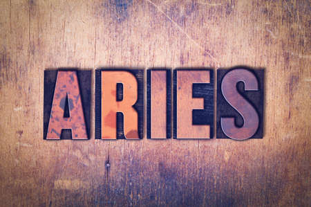 letterpress words: The word Aries concept and theme written in vintage wooden letterpress type on a grunge background. Stock Photo
