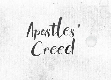 The words Apostles Creed concept and theme painted in black ink on a watercolor wash background. Stock Photo