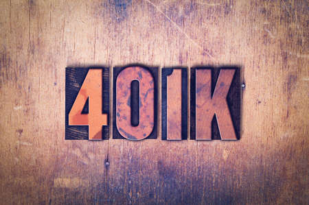 letterpress words: The word 401K concept and theme written in vintage wooden letterpress type on a grunge background. Stock Photo