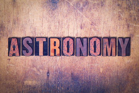 letterpress words: The word Astronomy concept and theme written in vintage wooden letterpress type on a grunge background.