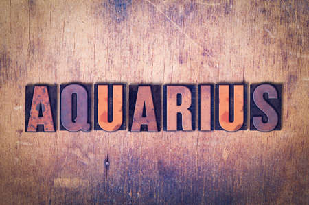letterpress words: The word Aquarius concept and theme written in vintage wooden letterpress type on a grunge background.