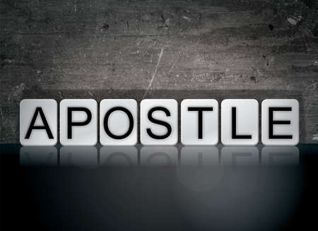 The word Apostle concept and theme written in white tiles on a dark background. 版權商用圖片