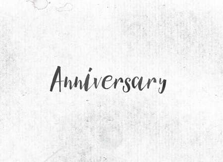 stock photo the word anniversary concept and theme painted in black ink on a watercolor wash background