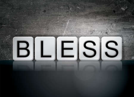 The word Bless concept and theme written in white tiles on a dark background. Banco de Imagens