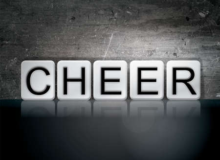 The word Cheer concept and theme written in white tiles on a dark background.