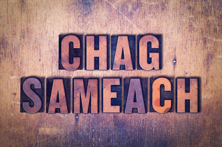 The words Chag Sameach concept and theme written in vintage wooden letterpress type on a grunge background.