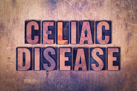 gastroenterology: The words Celiac Disease concept and theme written in vintage wooden letterpress type on a grunge background.
