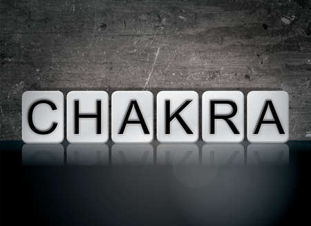 kundalini: The word Chakra concept and theme written in white tiles on a dark background.
