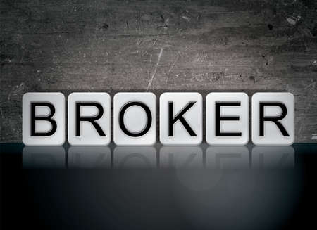 The word Broker concept and theme written in white tiles on a dark background. Banco de Imagens