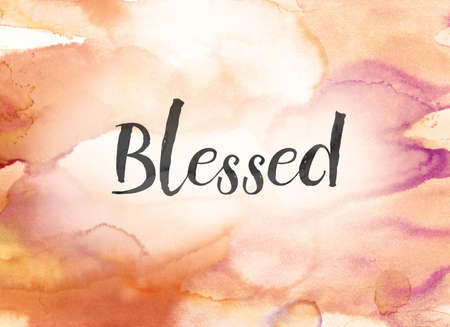The word Blessed concept and theme written in black ink on a colorful painted watercolor background. Stock Photo